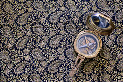 Compass. Himroo bedsheet& x28;background& x29; compass Royalty Free Stock Photos