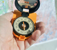 The compass in his hand. Royalty Free Stock Photos