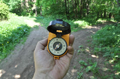 With a compass in his hand before the fork. Royalty Free Stock Images