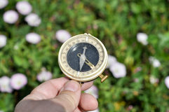 The compass in his hand. Royalty Free Stock Photo