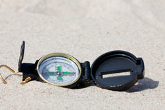 Compass in the hot desert Stock Images