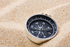 Compass on the hot sand Royalty Free Stock Photography