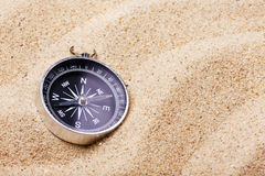 Compass on the hot sand Stock Image