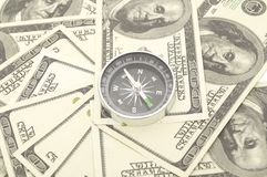 Compass on hundred dollar Stock Photos
