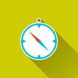Compass icon. Compass, windrose, travel gear, camping equipment - icon on green field backdrop. Flat design with long shadow. Trendy modern vector illustration Royalty Free Stock Photos
