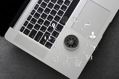 Compass with icons customer network connection on laptop Stock Photography