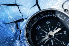 Compass on icy wall Royalty Free Stock Photography