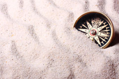 Compass In Sand Stock Photo