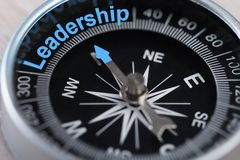 Compass indicating leadership. Closeup photo of compass indicating Leadership concept Stock Images