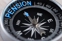 Compass indicating pension. Closeup of compass indicating Pension direction. Concept Shot Stock Images