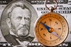 Compass Instrument in Front of a 50 US Dollar Bill. Conceptual Vintage Compass Instrument Standing in Front of a 50 US Dollar Bill, Emphasizing the Portrait of stock image