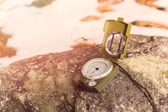 Compass instrument on rock Royalty Free Stock Photos