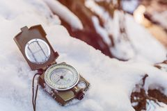 Compass instrument on snow Stock Images