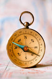Compass Instrument Standing on Top of Map royalty free stock image