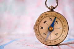 Compass Instrument Standing on Top of Map Royalty Free Stock Photography