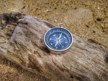 A compass showing your direction and your navigation by facing to the ocean. A compass is an instrument used for navigation and orientation that shows direction stock photo