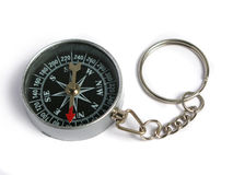 Compass keyring. Silver compass keyring on a white background Stock Images