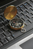 Compass on the laptop Stock Photography