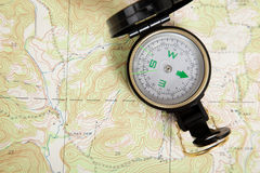 Compass laying on a map Royalty Free Stock Photo