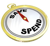 Compass - Leading the Way to Saving vs Spending. A compass with red needle pointing to the word Save and away from Spend, representing fiscal responsibility and Stock Photos
