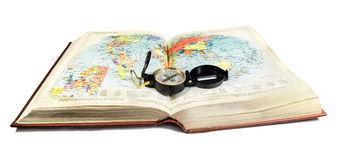 Compass lies on the terrain map,atlas book Royalty Free Stock Photography