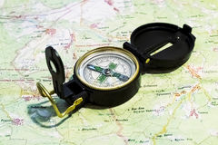 Compass lies on the terrain map Royalty Free Stock Photos