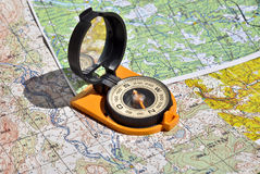 Compass lies on a topographic map. Stock Photography