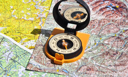 Compass lies on a topographic map. Royalty Free Stock Image
