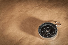 Compass on Light Brown Background Stock Photos