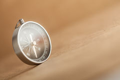 Compass on Light Brown Background Stock Photo