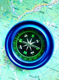 Magnetic compass blue on the road map. stock photo