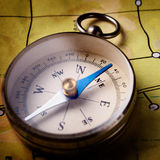 Compass lying on a map Stock Photo