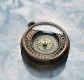 Compass. Made of brass on antique map Stock Image