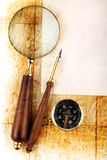 Compass and magnifier. On old textured paper stock images