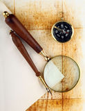 Compass and magnifier. On old textured paper royalty free stock photography