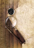 Compass and magnifier Royalty Free Stock Image