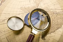 Compass and magnifier Stock Image