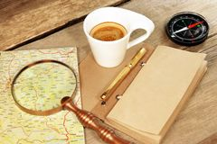 Compass Magnifier Vintage Notepad Gold Pen Coffee Cup Wood Table Stock Image