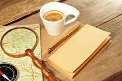 Compass Magnifier Vintage Notepad Gold Pen Coffee Cup Wood Table Royalty Free Stock Photography