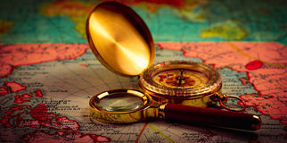 Compass and magnifying glass Stock Image