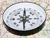 Compass on a map. An isolated compass on a driving map Stock Photos