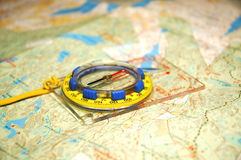 Compass and map. Colorful compass and a map Stock Photo