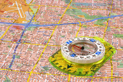 Compass on a map. Close up on a compass on a map Royalty Free Stock Photos