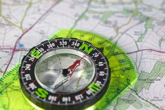 Compass on map. A compass with marked degrees and a north heading on a paper map Royalty Free Stock Photography