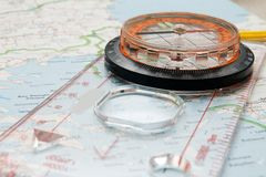 Compass on the map. Magnetic compass on the map of  mediterranian Stock Photo