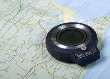 Compass and map. A electronic compass and the map stock image