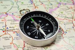 Compass and map. Compass on a road map stock photography