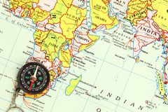 A compass on a map Royalty Free Stock Image