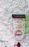 Compass on a map. Modern compass with map in background Stock Photos