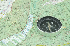 Compass and map. Compass on a map background stock images